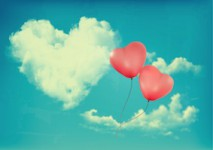 Retro Holiday background with heart shaped cloud on blue sky and red balloons. Valentine's Day. Vector illustration